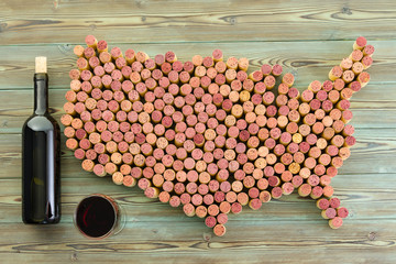 USA map of old wine corks with bottle and glass