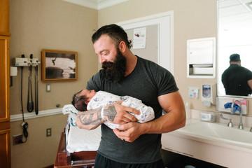 Father holding newborn