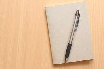 Pen and Notepad on the wooden background
