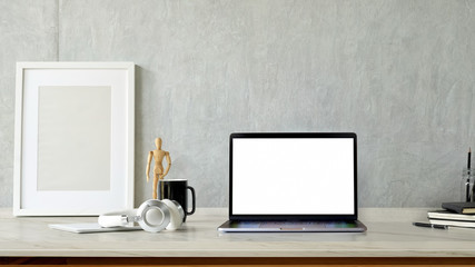Mockup blank screen laptop and poster on white desk. workspace and copy space