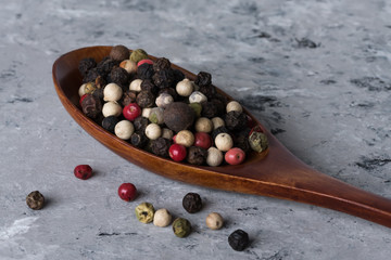 A Spoonful of multi colored peppercorns