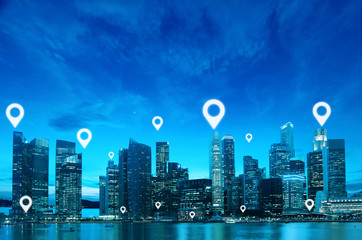 Location or Map pin flat above blue tone city scape and network connection concept