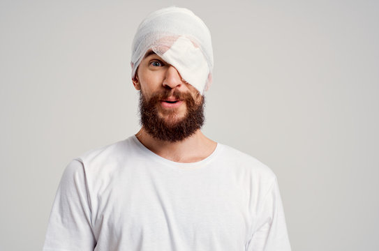 bandage on head bruised man