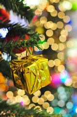 Christmas Gift Boxes in gold color wrappers with bokeh at background