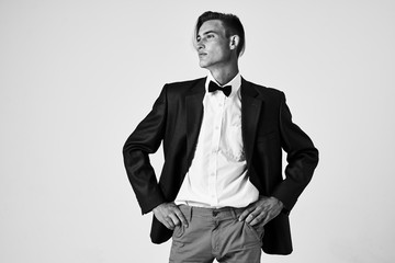 man in suit black and white photo