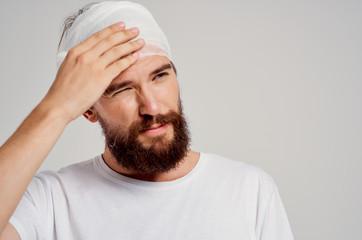 bearded man with bandaged head, operation