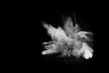 Launched white powder, isolated on black background.