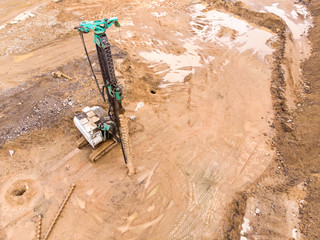 drilling rig standing at the construction site and ready for work. aerial top view