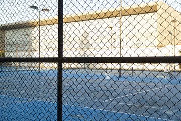 fence and tennis court