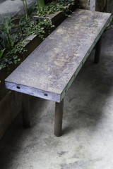 Grunge single bench in the garden