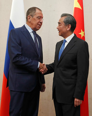 Russia's Foreign Minister Sergei Lavrov meets with China's Foreign Minister Wang Yi on the sidelines of the ASEAN Foreign Ministers' Meeting in Singapore