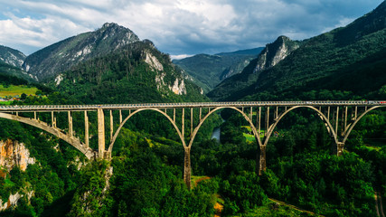 Aerial View of Durdevica Tara Arc Bridge in the Mountains, One of the Highest Automobile Bridges in Europe.