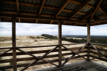 Wooden observation deck with a beautiful view of the dunes of the Curonian spit. Nida in Lithuania and Kaliningrad region in Russia