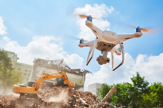 Drone inspecting construction demolition site or building area