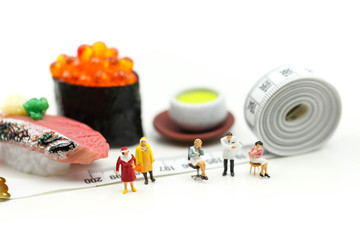 Miniature people : beautiful woman and doctor  with tape Measure of food diet,Healthcare and diet concept.