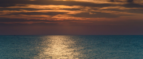 SEASCAPE - Picturesque cloudy sunset over the sea