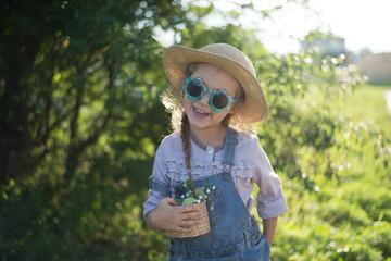 Happy face of little helper girl during fall gardening