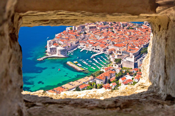 Dubrovnik historic city and harbor aerial view through stone window from Srd hill, Wall mural