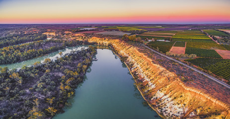 Aerial panorama of eroding sandstone shore of Murray RIver at sunset