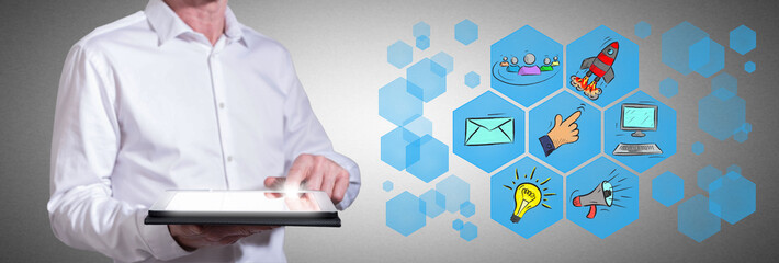 Digital marketing concept with man using a tablet