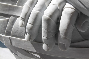 "Florence, Italy - May 23, 2011: hand closeup of ""In-Cinta""  work by the artist Rabarama in the open air in Florence"