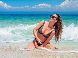 woman sunbathing on the beach