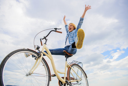 Woman feels happy while enjoy cycling. Girl rides bicycle sky background. How cycling changes your life and make you happy. Reasons to ride bicycle. Mental health benefits. Pedaling towards happiness
