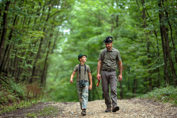 Ranger and his son in the woods