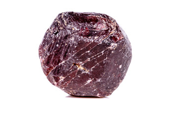 Macro of a mineral garnet stone on a white background