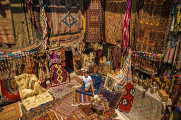 young man at old traditional Turkish carpet shop in cappadocia, turkey