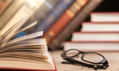 Wall Mural - Books and glasses on  table background