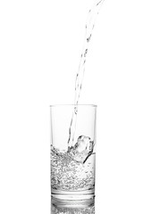 Water poured in  glass transparent white background