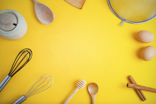 Tools pastry kitchen utensile for cooking dessert, over yellow background with copy space, still life. Top view.