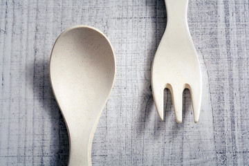 Set Of Bamboo Fork And Spoon In Children Size Lying Against Each Other, Learn To Use Cutlery As A Child Concept