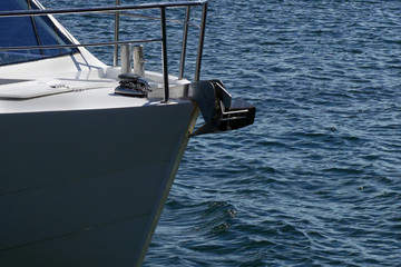 Bow of a sailing yacht  against the blue sea with anchor at the bow. copy space, selective focus, narrow depth of field