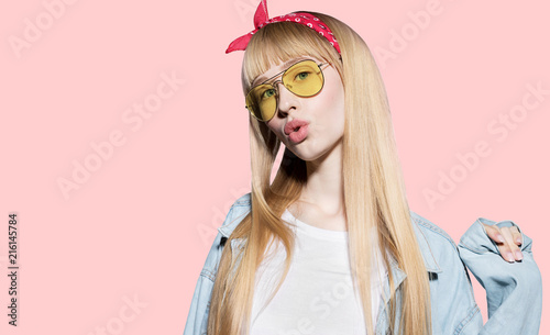 482f3214 Portrait of fashion cheerful young woman with beautiful long fair hair with  red bandage. Stylish blonde in blank white shirt and jeans jacket looking  at ...