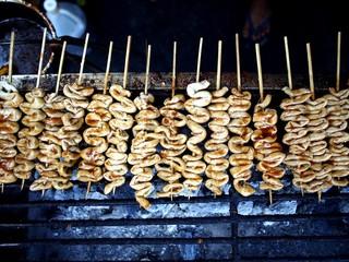 Grilled chicken intestine on a stick