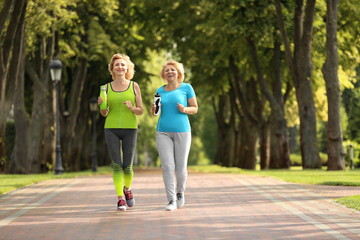 Sporty mature women training in park