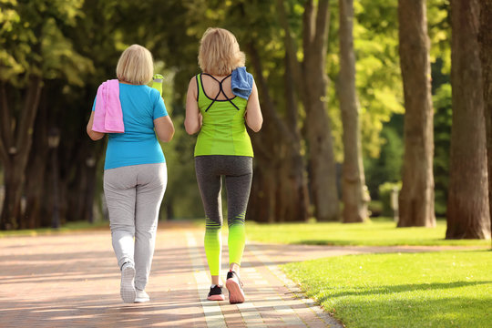Sporty mature women after training in park