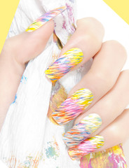 Long rainbow painted fingernails
