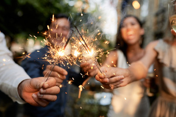 Friends with burning sparklers