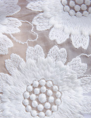 Detail of white lace flower design
