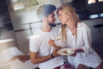 Beautiful girlfriend is feeding her handsome lover