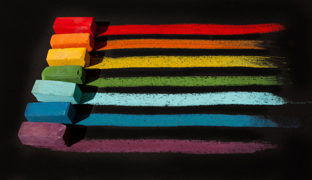 Multi-colored soft oil pastels in a row