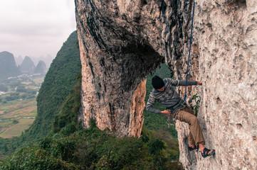 Sport climbing on limestone on Moon Hill, Yangshuo, Guangxi, China