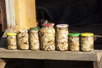 Marinated mushrooms in cans.