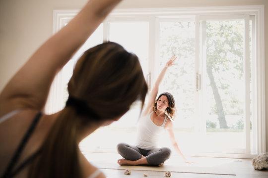 Yoga instructor with yogi at retreat