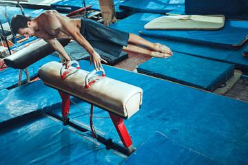 Printed kitchen splashbacks Gymnastics The sportsman during difficult exercise, sports gymnastics