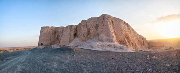 Panoramic view of ruins of Djanpik Qala: 9-10th century Khorezm fotress on sunset, Karakalpakstan region, Uzbekistan