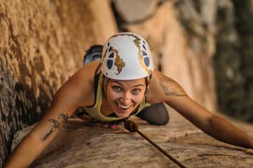 Rock climber rock climbing, looking at camera smiling, Red Rock, Las Vegas, Nevada, United States